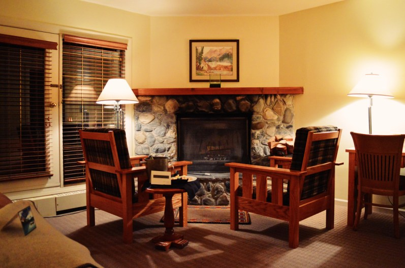 Sitting area in front of our open fire place | Emerald Lake Lodge gay-friendly © Coupleofmen.com