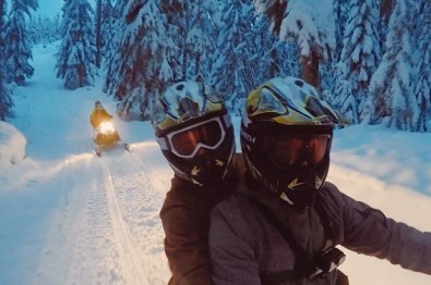 Hand-in-hand and arm-in-arm on a snowmobile | Zip Lining Snowmobiling TAG Whistler Gay-friendly © Coupleofmen.com
