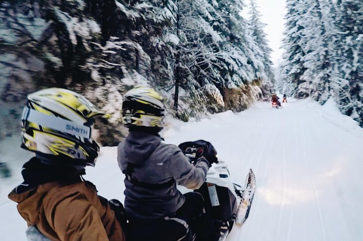 Karl & Daan riding a Ski-Doo | Zip Lining Snowmobiling TAG Whistler Gay-friendly © Coupleofmen.com
