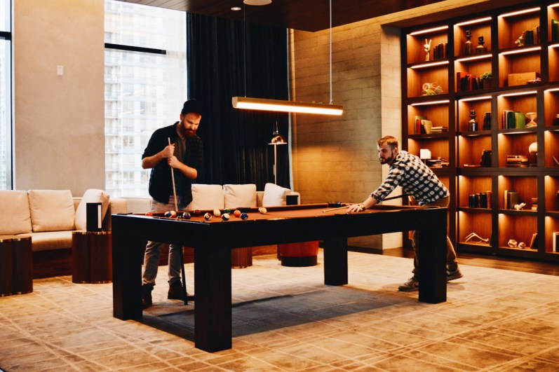 Playing Pool in the Lounge | The Douglas Vancouver Hotel gay-friendly © CoupleofMen.com