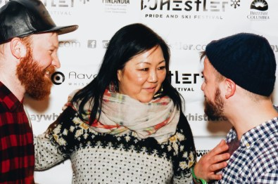 Couple of Men small talking with Margaret Cho, one of the greatest American comedians | Whistler Pride 2018 Gay Ski Week © Darnell Collins