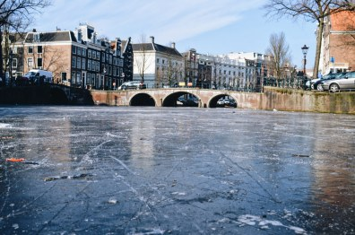 Thick Ice of the Frozen Canals in Amsterdam | Amsterdam Frozen Canals © Coupleofmen.com