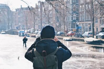 Karl taking some video shots of Prinsengracht | Amsterdam Frozen Canals © Coupleofmen.com