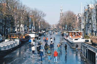 House-Boat Hotel and Westertoren | Amsterdam Frozen Canals © Coupleofmen.com