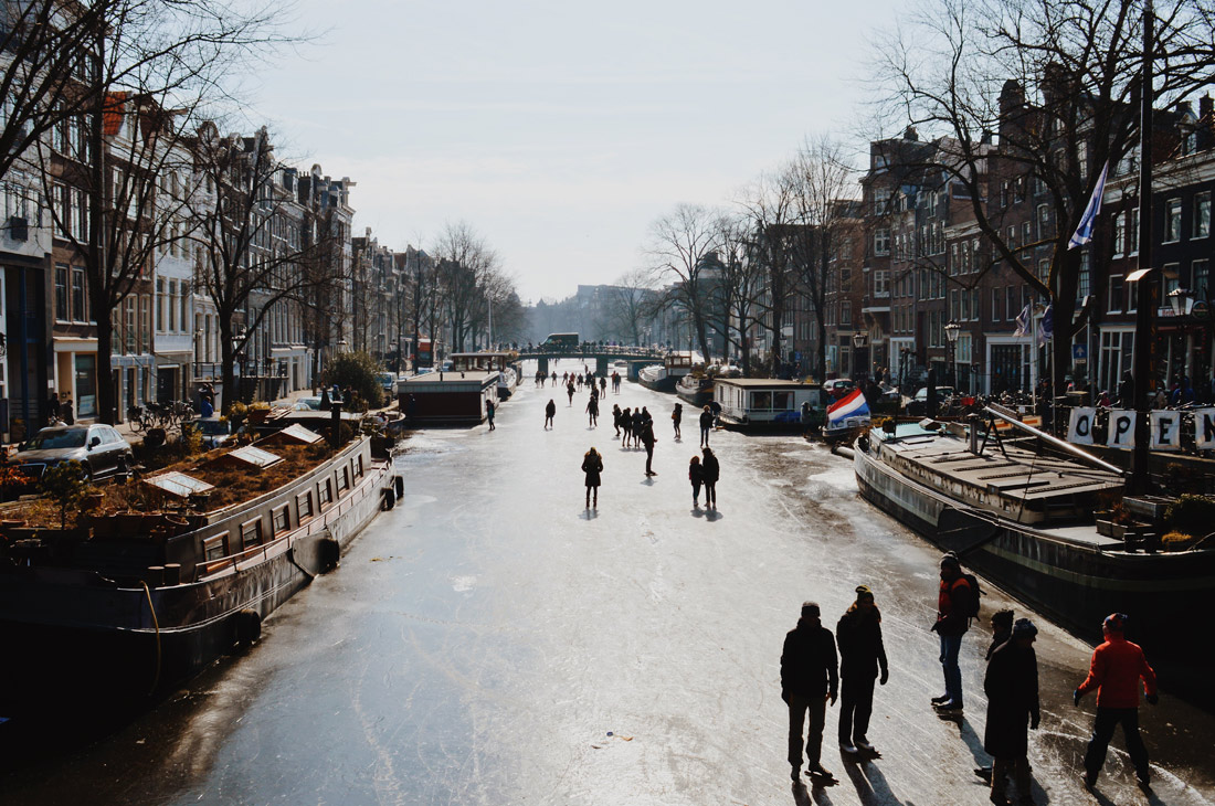 Winter on Amsterdam's frozen canals Ice-Skaters on Prinsengracht   Amsterdam Frozen Canals © Coupleofmen.com