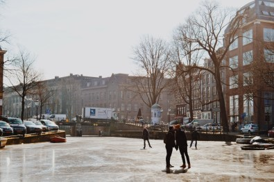 A Gay Couple's Kiss on the Prinsengracht   Amsterdam Frozen Canals © Coupleofmen.com