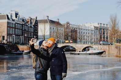 Winter on Amsterdam's Frozen Canals A Gay Kiss Selfie on the ice of the Keizersgracht | Amsterdam Frozen Canals © Coupleofmen.com