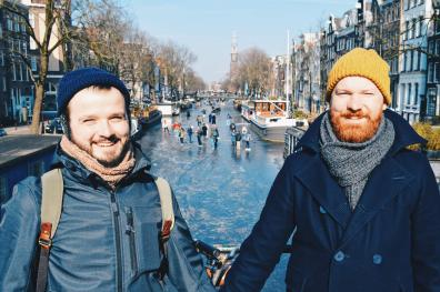 Hand-in-hand with frozen canals as a backdrop   Amsterdam Frozen Canals © Coupleofmen.com