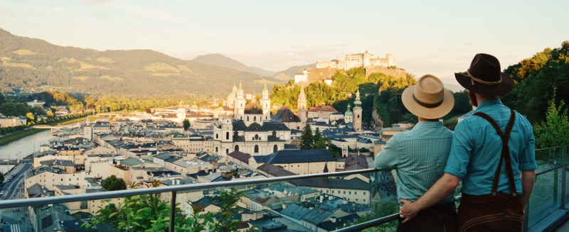 Travel Salzburg: Our Gay Couple City Trip Arm-in-arm in front of the Fortress Salzburg © coupleofmen.com