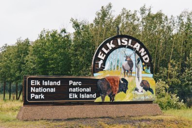 Welcome sign at the gates to Elk Island National Park | Road Trip Edmonton Northern Alberta © Coupleofmen.com