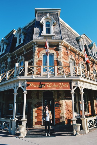 Karl in front of our hotel, the Prince of Wales Hotel & Spa in Niagara-on-the-Lake | Must Do's Niagara Falls Canada © Coupleofmen.com
