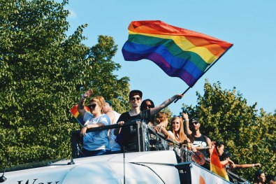 Queer participant waving the rainbow flag from a truck | CSD Berlin Gay Pride 2018 © Coupleofmen.com