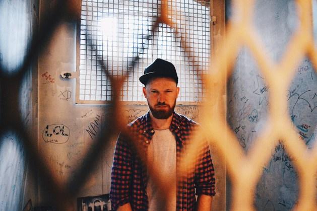 Daan caught in the act enjoying to explore the prison cells | Katajanokka Hotel Helsinki Gay-friendly Review © Coupleofmen.com