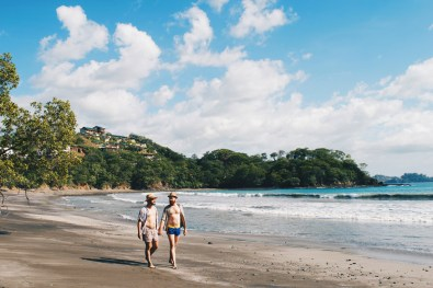 Walking hand-in-hand along Playa Danta and the new Costa Rican village Las Catalinas | Gay-friendly Costa Rica © Coupleofmen.com
