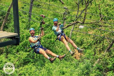 Zip Lining together at Diamante Eco Adventure Park | Gay-friendly Costa Rica © Coupleofmen.com