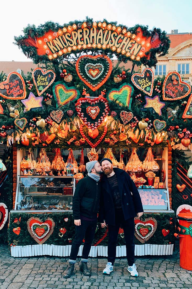 Christmas kiss in front of the gingerbread house on the Dresden Christmas market © Coupleofmen.com