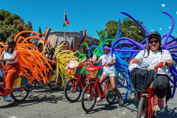 Pride comes in all colors and in all its facets even on bikes with balloons! © Coupleofmen.com