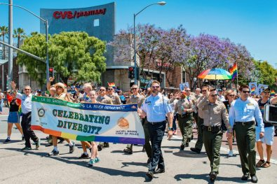 LAPD celebrating Diversity - We had to cry a little seeing LA Police men marching LA Pride hand-in-hand 2019 LA Pride West Hollywood © Coupleofmen.com