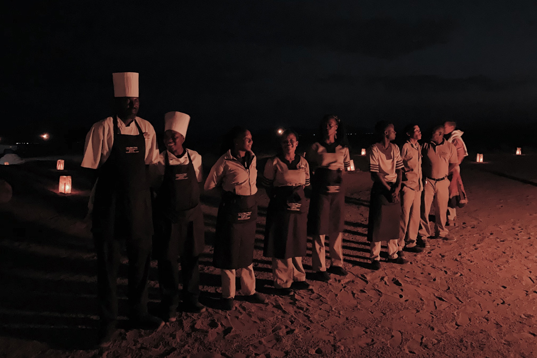 Welcome song by the staff of the Sossusvlei Lodge for our bush dinner under the stars © Coupleofmen.com
