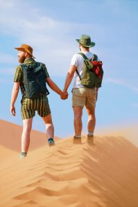 Hand-in-hand to the top of Big Daddy Dune at Sossusvlei Dunes in the Namib Desert © Coupleofmen.com