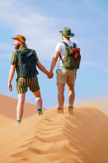 Hand-in-hand to the top of Big Daddy Dune at Sossusvlei Dunes in the Namib Desert © Coupleofmen.com