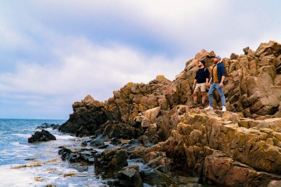 Gay Summer Road Trip Skåne Hand-in-hand at the rocky coast of Kullaberg Nature Reserve © Coupleofmen.com