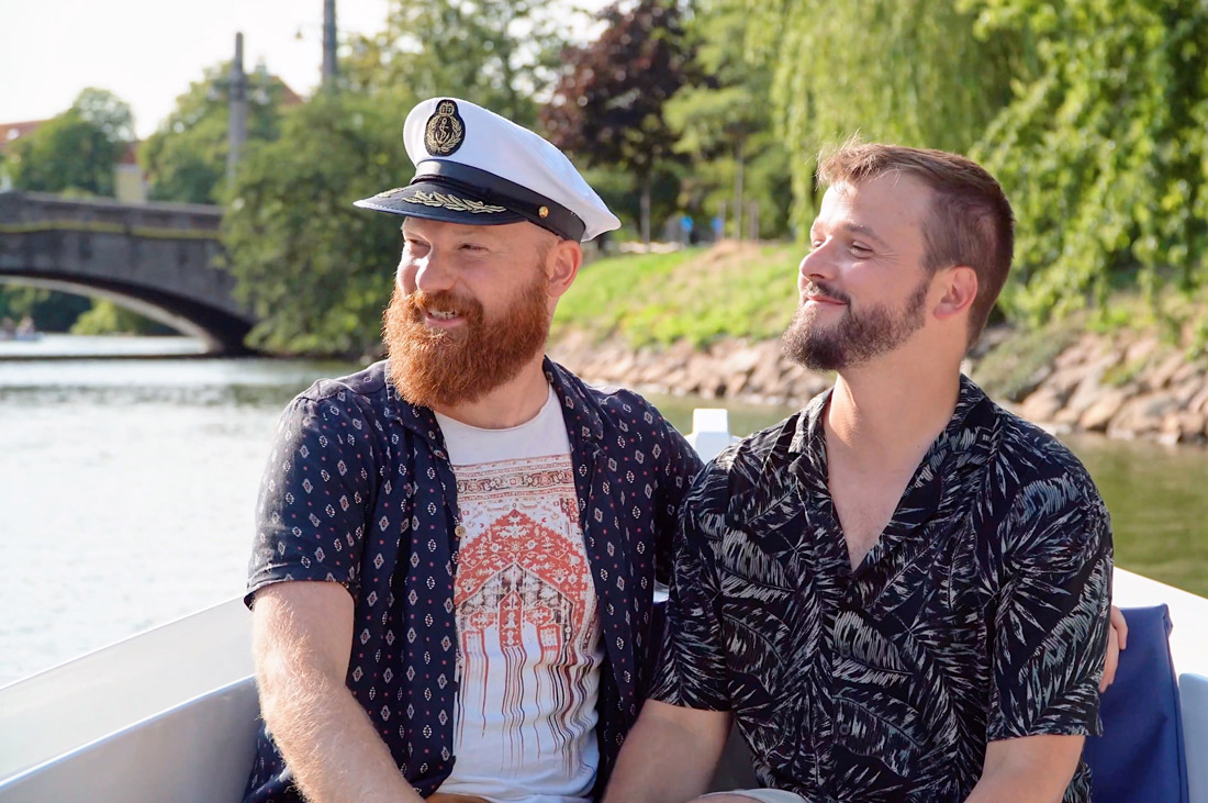 Malmö Gay City Trip South Sweden Happily enjoying a Boat Tour in Malmö together as a gay couple © Coupleofmen.com