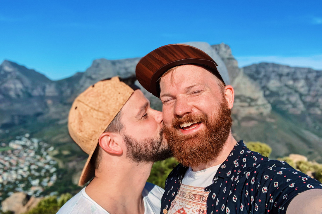 Gay Couple City Trip Cape Town So happy we made it! Gay kiss on top of Lion's Head - Cape Town © Coupleofmen.com