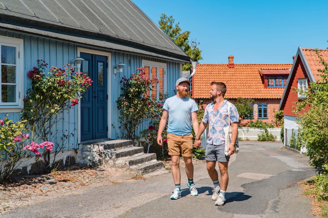 Gay Summer Road Trip Skåne Walking hand-in-hand around Kivik with its gorgeous Swedish houses © Coupleofmen.com