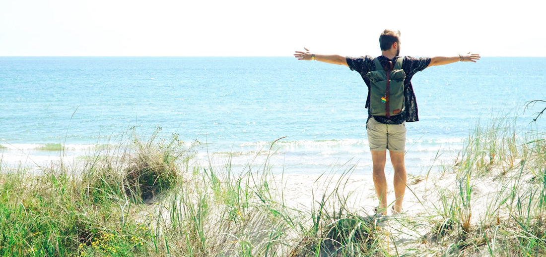 Karl is happy after we finally arrived at the gay beach of Sandhammaren © Coupleofmen.com