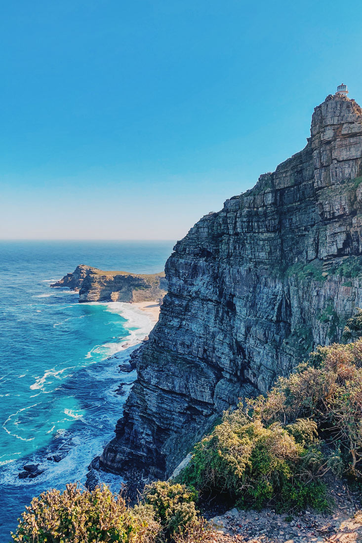 The rough southern coast of the Cape Peninsula with the little Cape Point Lighthouse on the top © Coupleofmen.com