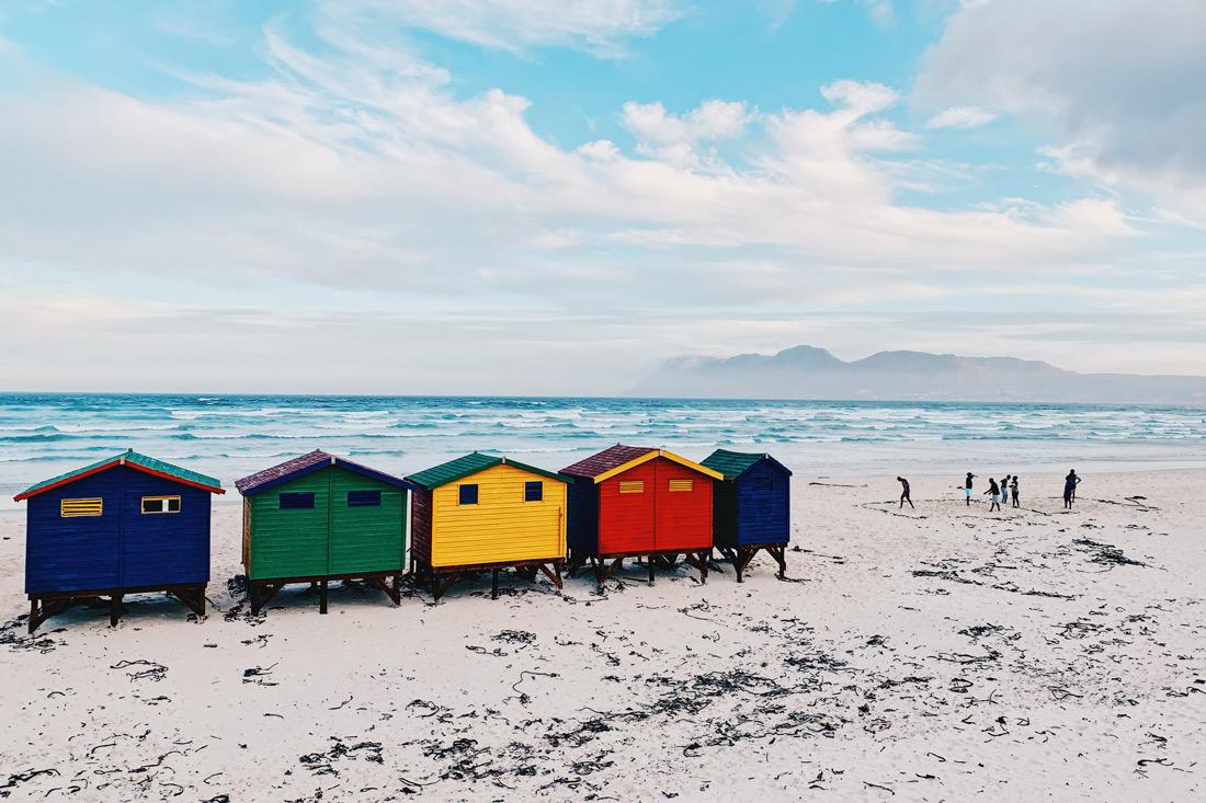 The world-famous colored beach houses of Muizenberg Beach © Coupleofmen.com