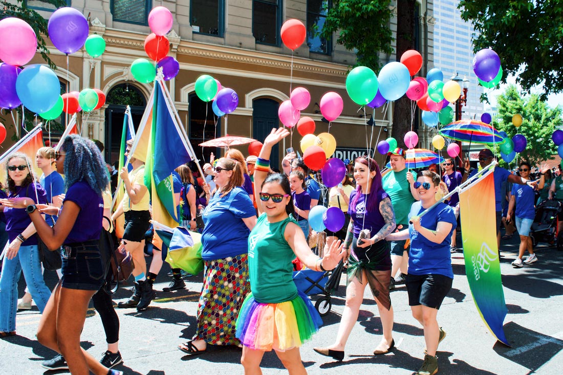 Summer colors, balloons, and happy face during Portland Pride Parade © Coupleofmen.com
