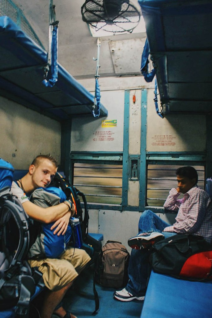 Karl sitting in third class in a train from New Delhi to Agra © Coupleofmen.com
