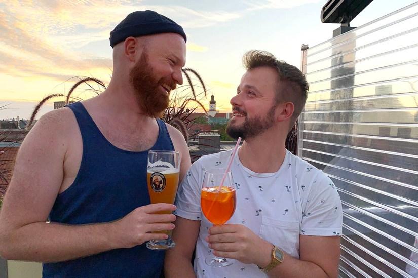 Munich Gay City Trip Perfect sun set moment with a drink at Deutsch Eiche Rooftop Bar © Coupleofmen.com