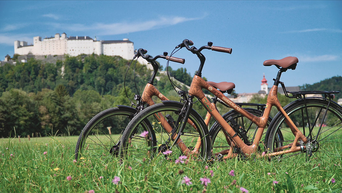 Rental bikes from the Arte Hotel with the Fortress Hohensalzburg in the background © Coupleofmen.com