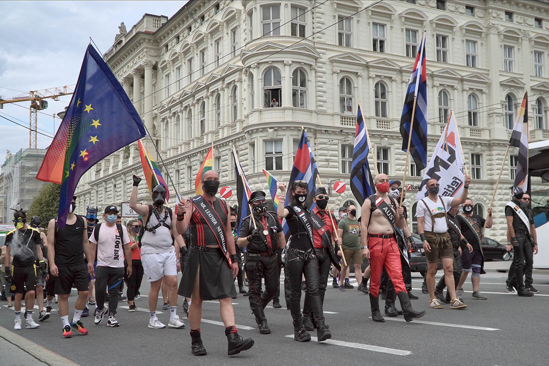 Flags and Leather Men in front of the CSD Salzburg Pride © Coupleofmen.com