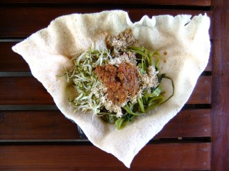 Delicious coconut vegetables served on a prawn cracker, Indonesia