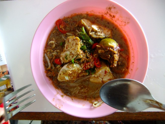 Just about to tuck into a laksa (coconut curry noodle soup), Malaysia