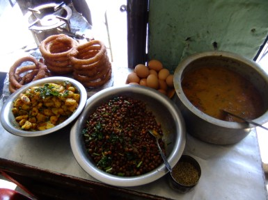 Typical components of a delicately spiced Nepali meal - potatoes, chickpeas and dal soup (and some doughnuts!)