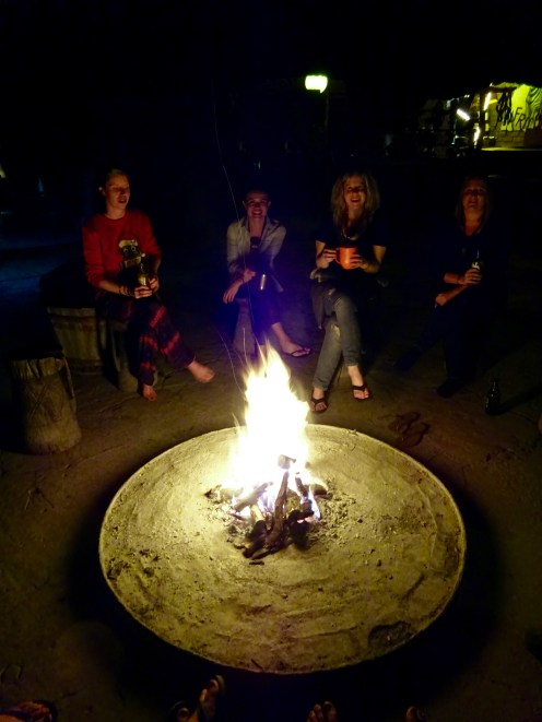 Drinks around the camp fire