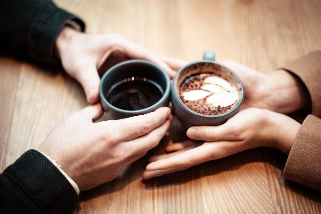 Couple on a covid-19 date together having coffee.