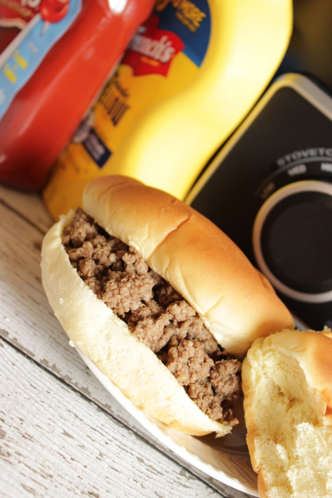 These are SO awesome! I make them for parties all the time. This is also the ULTIMATE tailgate food! Maid Rite recipe - Crockpot Loose Meat Sandwiches, perfectly seasoned and served on warm hamburger buns.