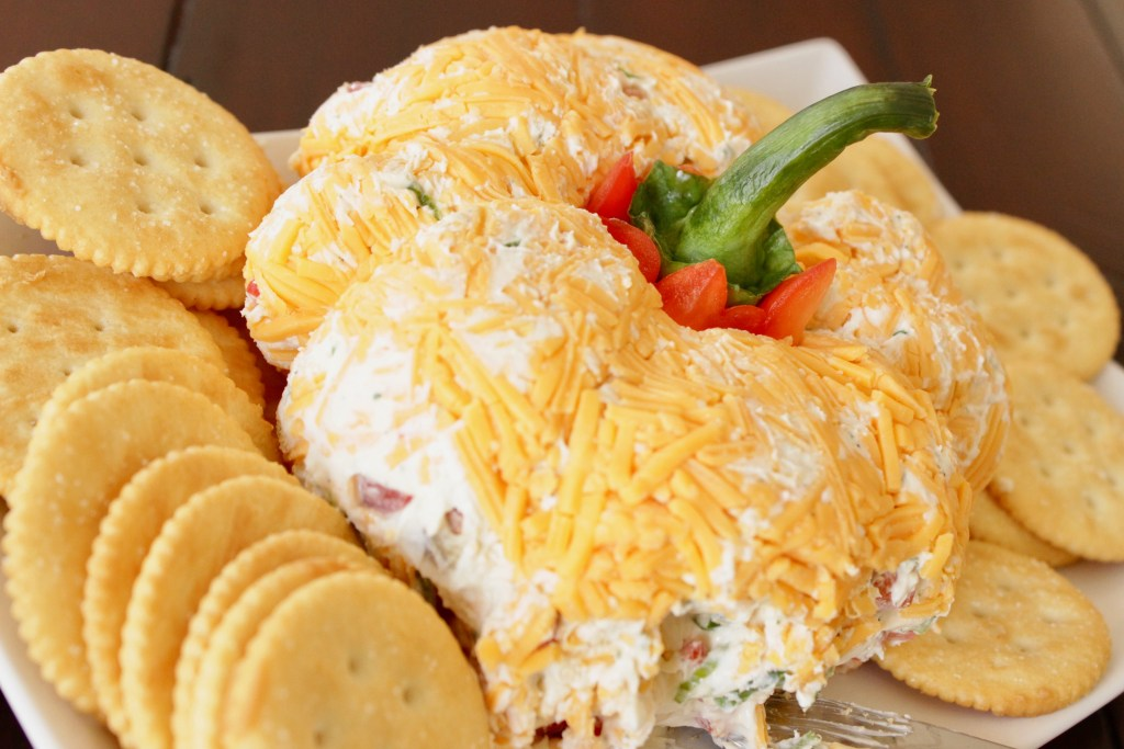 This pumpkin shaped cheese ball is one of those perfect easy appetizers for a party!