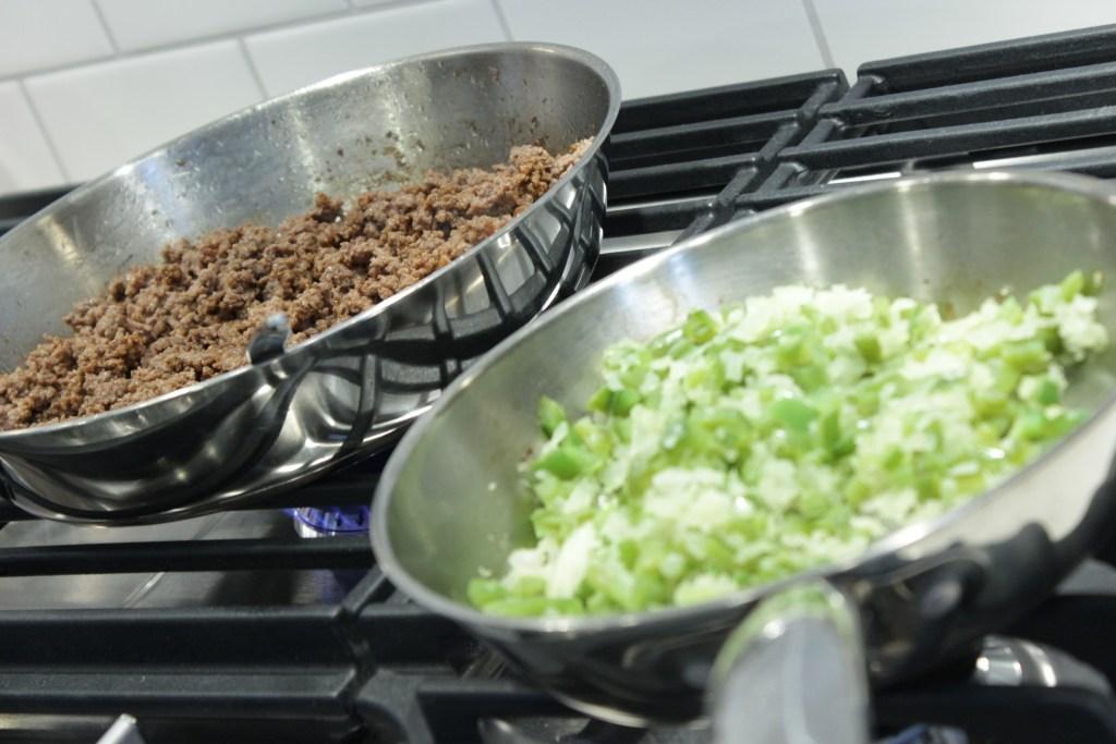 cooking philly cheese steak sloppy joe ingredients separately in pans