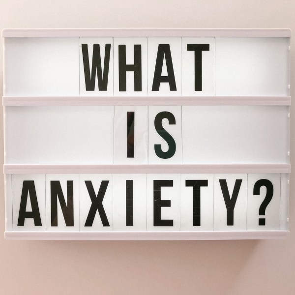 LED light box that says what is anxiety for a mental health blog
