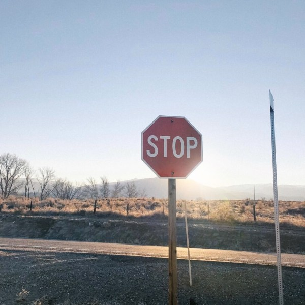 Picture of a stop sign in Nampa Idaho with the sun shining behind it as the sun sets