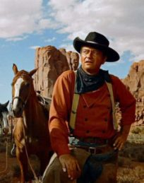 "John Wayne dans ""The Searchers"" de John Ford.John Wayne dans ""The Searchers"" de John Ford."