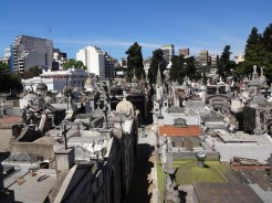 Modern buildings of Buenos Aires can be seen behind the cemetery in this view from above.