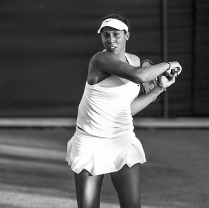 Madison Keys in a flowing skirt and gathered top by Nike Court